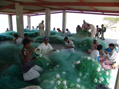 Fishermen making fishing nets in Gwadar, to be sold later