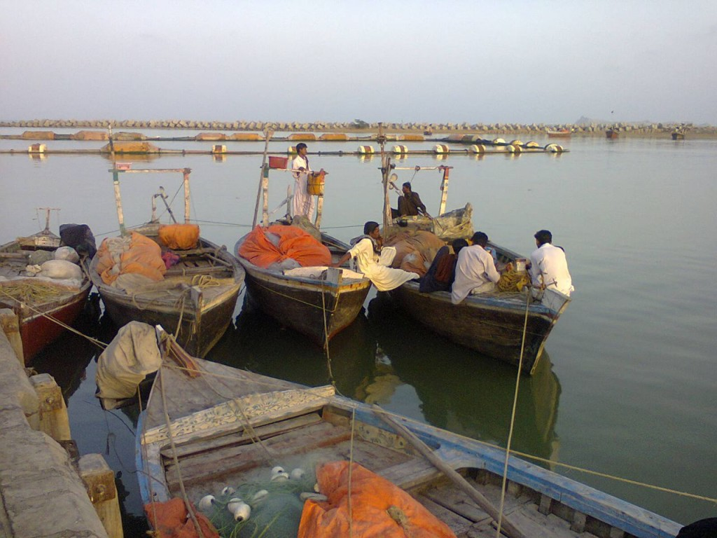 Fishermen with their boats at Pasni Harbor